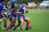 Michelangelo Sosene-Feagai is tackled by Penitoa Finau. Counties Manukau Premier Club Rugby game between Ardmore Marist and Manurewa, played at Bruce Pulman Park Papakura on Saturday May 12th 2018. Ardmore Marist won the game 20 - 3 after leading 17 - 3 at halftime.<br /> Ardmore Marist - Katetistoti Nginingini try, penalty try, Latiume Fosita conversion, Latiume Fosita 2 penalties.<br /> Manurewa - Logan Fonoti penalty.<br /> Photo by Richard Spranger.