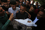 Palestinian mourners carry the body of Saba Abu Arar during her funeral in Gaza City on May 5, 2019. More than 450 rockets have so far been launched at Israel, as the Israeli army struck hundreds of Hamas and Islamic Jihad targets in the Strip. Photo by Ashraf Amra