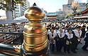 Japanese businessmen praying for thriving business at Tokyo's Kanda Myojin