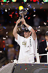 Green Bay Packers quarterback Aaron Rodgers (12) holds up the Lombadi Trophy after winning Super Bowl XLV against the Pittsburgh Steelers on Sunday, February 6, 2011, in Arlingto, Texaas. The Packers won 31-25. (AP Photo/David Stluka)