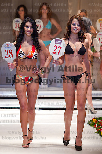 Zsofia Botos (left) and Nora Virag (right) attends the Miss Hungary 2010 beauty contest held in Budapest, Hungary on November 29, 2010. ATTILA VOLGYI