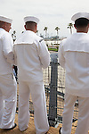 Sailors look across to the SS Lane Victory from the final voyage of the battleship USS Iowa from Berth 51 to its new home at Berth 87 in San Pedro, Los Angeles, CA where it opens as a museum ship in July 2012.