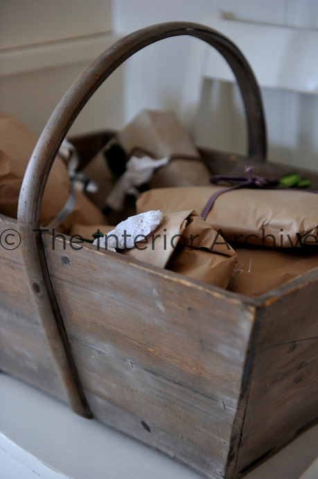 Detail of Christmas presents wrapped up in brown paper