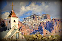 A western chapel in Apache Junction set against snow on at Lost Dutchman State Park.