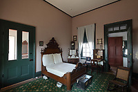 Master bedroom of the Commanding Officer's quarters, on Officers' Row, at Fort Davis National Historic Site, a US army fort established 1854, in a canyon in the Davis Mountains in West Texas, USA. The house was begun in 1867 under Lieutenant Colonel Wesley Meritt, but has been refurbished to the time of Colonel Benjamin Grierson, commander of the black Tenth US Cavalry, and his family, who lived here 1882-85. The fort was built to protect emigrants, mail coaches, and freight wagons on the trails through the State from Comanche and Apache Indians. After the Civil War, several African-American regiments were stationed here. By the 1880s, the fort consisted of one 100 buildings, housing over 400 soldiers. It was abandoned in 1891, but many buildings have been restored and the compound now operates as a historical site and museum. Picture by Manuel Cohen