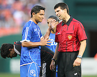 Victor Turcios #3 of El Salvador listens to referee Michael Donavon during an international charity match against D.C. United at RFK Stadium, on June 19 2010 in Washington DC. D.C. United won 1-0.