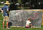 A large blackboard on which writing is encouraged near the Family Stage, at the 2012 Clearwater Festival at Croton Point Park on Saturday, June 16, 2012. Photograph taken by Jim Peppler. Copyright Jim Peppler/2012