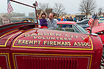 March 31, 2013 - Garden City, New York, U.S. - The Garden City Volunteer Exempt Firemans Association brought its 1932 Ford Fire Engine and posters aboutr recruiting volunteers to the 58th Annual Easter Sunday Vintage Car Parade and Show sponsored by the Garden City Chamber of Commerce. Hundreds of authentic old motorcars, 1898-1988, including antiques, classic, and special interest participated in the parade.