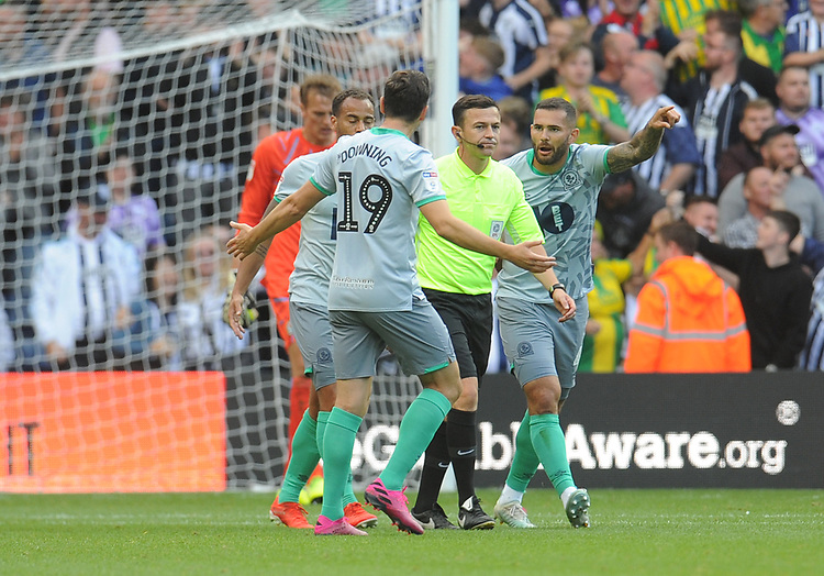 Blackburn Rovers' Stewart Downing, Elliott Bennett and Bradley Johnson surround referee Tony Harrington after West Bromwich Albion's Matt Phillips (not in picture) scores his side's first goal  <br /> <br /> Photographer Kevin Barnes/CameraSport<br /> <br /> The EFL Sky Bet Championship - West Bromwich Albion v Blackburn Rovers - Saturday 31st August 2019 - The Hawthorns - West Bromwich<br /> <br /> World Copyright © 2019 CameraSport. All rights reserved. 43 Linden Ave. Countesthorpe. Leicester. England. LE8 5PG - Tel: +44 (0) 116 277 4147 - admin@camerasport.com - www.camerasport.com
