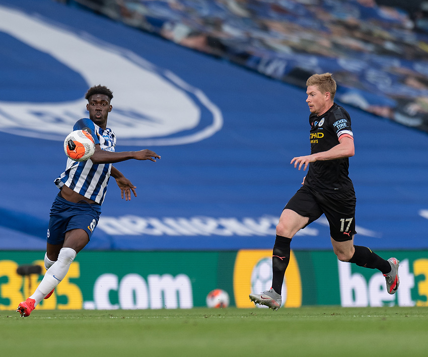 Brighton & Hove Albion's Yves Bissouma (left) under pressure from  Manchester City's Kevin De Bruyne <br /> <br /> Photographer David Horton/CameraSport<br /> <br /> The Premier League - Brighton & Hove Albion v Manchester City - Saturday 11th July 2020 - The Amex Stadium - Brighton<br /> <br /> World Copyright © 2020 CameraSport. All rights reserved. 43 Linden Ave. Countesthorpe. Leicester. England. LE8 5PG - Tel: +44 (0) 116 277 4147 - admin@camerasport.com - www.camerasport.com