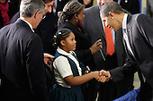 United States President Barack Obama (R) greets a young student after signing the Healthy, Hunger-Free Kids Act of 2010 at Harriet Tubman Elementary School, Monday, December 13, 2010 in Washington, DC. In an effort to provide children with better school lunches and breakfasts, the new law puts $4.5 million in the hands of child nutrition programs, sets nutrition standards on school vending machines, helps create school gardens and makes sure that quality drinking water is available during meal times.  .Credit: Chip Somodevilla - Pool via CNP