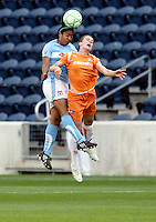 Chicago Red Star midfielder Chioma Igwe (12) heads the ball over Sky Blue FC midfielder Heather O'Reilly (9).  The Sky Blue FC defeated the Chicago Red Stars 2-0 at Toyota Park in Bridgeview, IL on May 10, 2009.