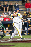 Michigan Wolverines first baseman Drew Lugbauer (17) follows through on his swing against the Eastern Michigan Hurons on May 3, 2016 at Ray Fisher Stadium in Ann Arbor, Michigan. Michigan defeated Eastern Michigan 12-4. (Andrew Woolley/Four Seam Images)