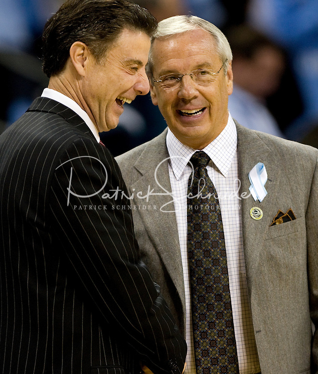 Louisville coach Rick Pitino and North Carolina coach Roy Williams during the NCAA Basketball Men's East Regional at Time Warner Cable Arena in Charlotte, NC.
