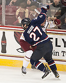 Cody Sharib (UConn - 27), Michael Matheson (BC - 5) - The Boston College Eagles defeated the visiting University of Connecticut Huskies 3-2 on Saturday, January 24, 2015, at Kelley Rink in Conte Forum in Chestnut Hill, Massachusetts.