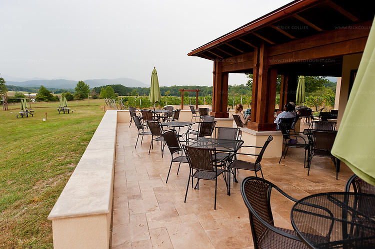 Plenty of seating are available on patio and surrounding lawn, outside the tasting room at Afton Mountain Vineyards.