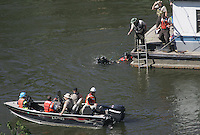 Minneapolis, Minn.- Search and recovery divers, and teams with recovery dogs working to locate survivals, or bodies, in the area of collapse of the Interstate 35W  freeway bridge in Minneapolis, Thursday, Aug. 2, 2007.