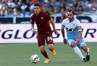 Calcio, Serie A: Lazio vs Roma. Roma, stadio Olimpico, 25 maggio 2015.<br /> Roma's Alessandro Florenzi, left, is chased by Lazio's Santiago Gentiletti during the Italian Serie A football match between Lazio and Roma at Rome's Olympic stadium, 25 May 2015.<br /> UPDATE IMAGES PRESS/Riccardo De Luca