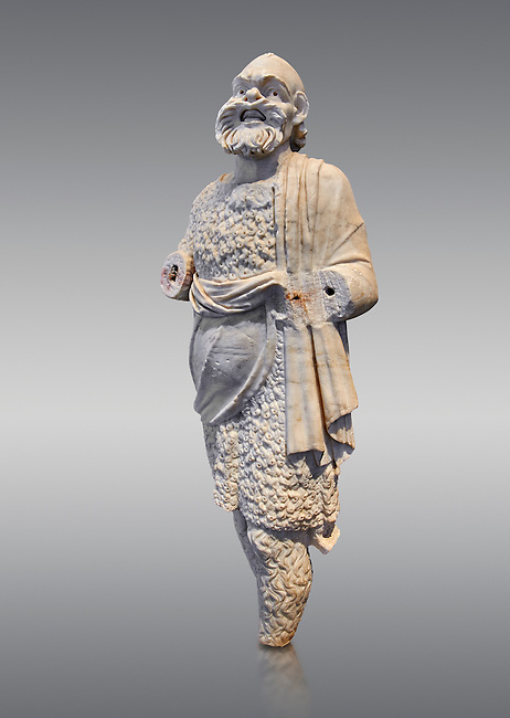 Roman statue of Silenus or Papposilenus from the second half of the 2nd cent. AD excavated from the Villa Marittima, Torre Astura Italy.  Silenus was the tutor to Dionysus is portrayed here as he was portrayed on stage in the Roman theatres. His mask is that of the theatre and he is wearing a lambskin cloak and hairy tights.  Inv 135769, The National Roman Museum, Rome, Italy