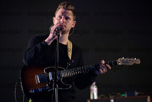 ALT-J - vocalist guitarist Joe Newman - performing live on the King Tut stage at T in the Park Festival 2012 held at Balado Scotland UK - 07 July 2012.   Photo credit: Derren Nugent/IconicPix