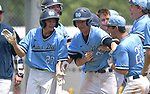 Mater Dei teammates Tanner Gerdes (left) and Nick Burg (right) surround Drew Dant and celebrate his game-winning grand slam as Mater Dei defeated Althoff in the Class 2A regional baseball championship game played at Northside Park in Breese, IL on Saturday May 18, 2019.<br /> Tim Vizer/Special to STLhighschoolsports.com