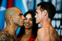 Puerto Rico boxer Miguel Cotto (L ) see to the eyes to Australia boxer Daniel Geale during an official weigh-in ahead of his fight against  at Barclays Center in New York.  06/05/2015. Eduardo MunozAlvarez/VIEWpress