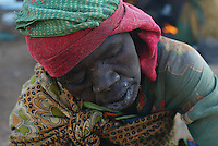 an alederly woman suffers the cold in the Farchana refugee camp on Jan 2005 in Chad