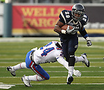 Nevada running back Lampford Mark (29) runs against Louisiana Tech defender Dave Clark (24) during the first quarter of an NCAA football game Saturday, Nov. 19, 2011, in Reno, Nev. Louisiana Tech won 24-20. (AP Photo/Cathleen Allison)