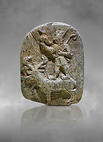 Plaque depicting the Hittite Protector of the wild standing on the back of a deer. Steatite - 14th - 13th century BC - Corum Yenikoy  - Museum of Anatolian Civilisations, Ankara, Turkey