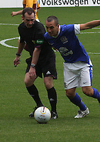 Leon Osman collides with match referee Stevie O'Reilly in the Motherwell v Everton friendly match at Fir Park, Motherwell on 21.7.12 for Steven Hammell's Testimonial.