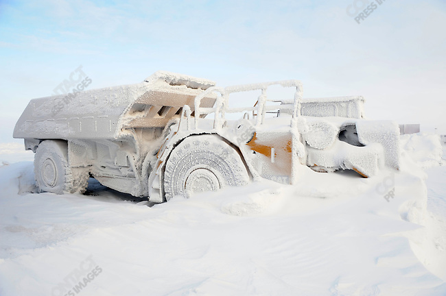 At the Kupol gold mine in Chukotka operated by the Canadian company Kinross, a snowy arctic landscape framed a snow and ice encrusted truck. Russian Far East, February 7, 2011