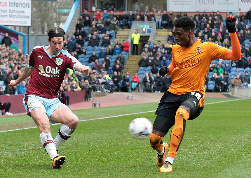 Burnley's George Boyd gets a cross in past Wolverhampton Wanderers' Kortney Hause<br /> <br /> Photographer David Shipman/CameraSport<br /> <br /> Football - The Football League Sky Bet Championship - Burnley v Wolverhampton Wanderers - Saturday 19th March 2016 - Turf Moor - Burnley<br /> <br /> &copy; CameraSport - 43 Linden Ave. Countesthorpe. Leicester. England. LE8 5PG - Tel: +44 (0) 116 277 4147 - admin@camerasport.com - www.camerasport.com