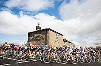 Picture by Alex Whitehead/SWpix.com - 03/05/2015 - Cycling - 2015 Tour de Yorkshire: Stage 3, Wakefield to Leeds - The peloton passes The Ford Inn in Holmfirth during Stage 3.