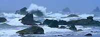 972500008 panoramic view - a pacific ocean storm drives crashing waves over the sea stacks and beach along harris state beach just north of brookings on the southern oregon coast