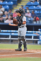 Hickory Crawdads catcher Ricky Valencia (15) during a game against the Asheville Tourists at McCormick Field on July 13, 2017 in Asheville, North Carolina. The Tourists defeated the Crawdads 9-4. (Tony Farlow/Four Seam Images)