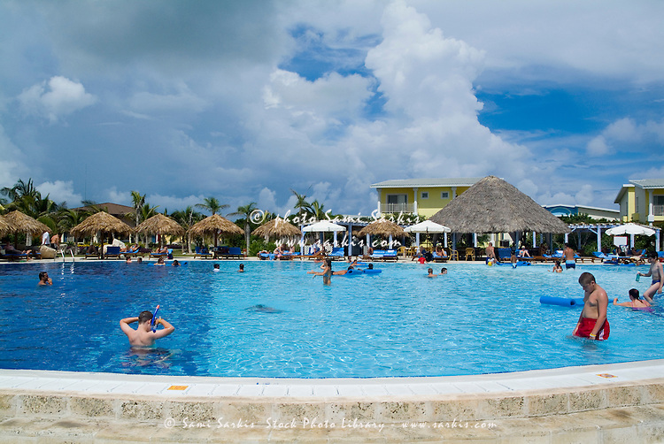 People bathing in a swimming pool and sunbathing at a resort, Cayo Santa-Maria, Cuba.