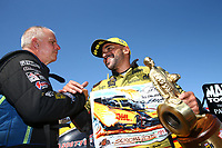 Jul 30, 2017; Sonoma, CA, USA; NHRA funny car driver Tim Wilkerson (left) congratulates J.R. Todd as he celebrates after winning the Sonoma Nationals at Sonoma Raceway. Mandatory Credit: Mark J. Rebilas-USA TODAY Sports