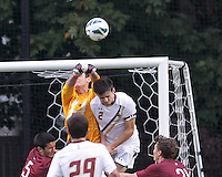 Corner kick. Harvard University goalkeeper Brett Conrad (1) punches ball away from Boston College defender Chris Ager (2)Boston College (white) defeated Harvard University (crimson), 3-2, at Newton Campus Field, on October 22, 2013.