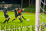 Strike on Target<br /> ---------------------<br /> David Courtney, drives low and hard to score his 2nd goal for Park against Tralee Dynamos as Oliver Coffey tries to stop the shot, when the sides met last Friday night at the KDL, Mounthawk, Tralee.