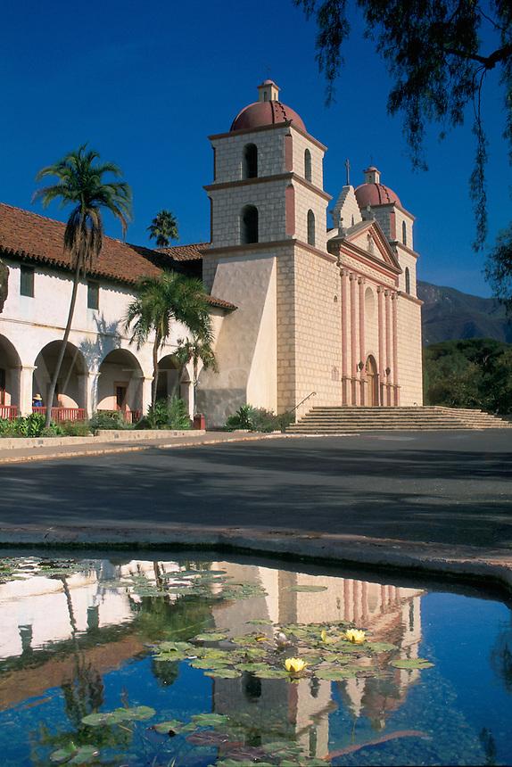 Reflection in water fountain of the Mission Santa Barbara, Spanish adobe architecture building, built 1786, Mission Park, Santa Barbara, California.