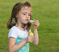 NWA Democrat-Gazette/J.T. WAMPLER McKenzie Sauerbry, 6, blows soap bubbles Friday May 26, 2017 at Murphy in May, an event celebrate the re-opening of Murphy Park in Springdale. There was live music from Leah and the Mojo Doctors and food truck vendors. Murphy Park will host several events this summer with more live music and outdoor movies on the schedule. For more information go to www.springdalear.gov/235/Parks-Recreation. Sauerbry was at the park with her mom, Erin Sauerbry of Springdale.