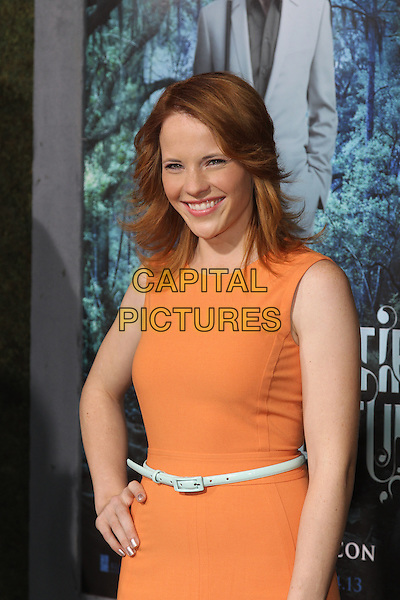 """Katie Leclerc.""""Beautiful Creatures"""" Los Angeles Premiere held at the TCL Chinese Theatre, Hollywood, California, USA. .February 6th, 2013.half length dress hand on hip orange sleeveless green belt .CAP/CEL .©CelPh/Capital Pictures."""