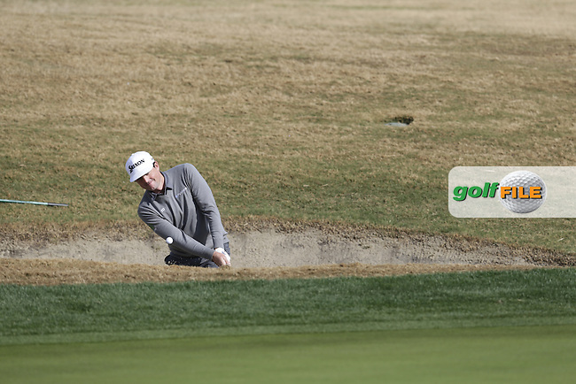 Keegan Bradley (USA) chips from a bunker at the 17th green during Thursday's Round 1 of the 2017 CareerBuilder Challenge held at PGA West, La Quinta, Palm Springs, California, USA.<br /> 19th January 2017.<br /> Picture: Eoin Clarke | Golffile<br /> <br /> <br /> All photos usage must carry mandatory copyright credit (&copy; Golffile | Eoin Clarke)