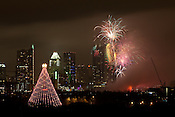 The City of Austin sets off fireworks downtown to celebrate the new year. The Zilker Park Christmas Tree stands in the foreground. December 31, 2012. CREDIT: Lance Rosenfield/Prime