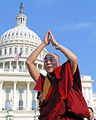 Washington, DC - October 17, 2007 -- The 14th Dalai Lama, Tenzin Gyatso, blesses the crowd after making a speech on the West Lawn of the United States Capitol in Washington, D.C. on Wednesday, October 17, 2007.  Earlier, inside the Rotunda of The Capitol the Dalai Lama accepted the Congressional Gold Medal, the nation's highest and most distinguished civilian award..Credit: Ron Sachs/CNP