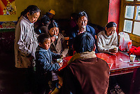 Tibetan family at the teahouse, Ganden Monastery, Dagze, Tibet (Xizang), China.