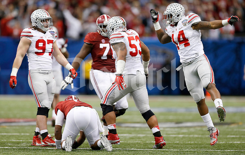 Ohio State Buckeyes defensive lineman Joey Bosa (97) and Ohio State Buckeyes linebacker Curtis Grant (14) celebrate after Ohio State Buckeyes defensive tackle Michael Bennett (53) sacked Alabama Crimson Tide quarterback Blake Sims (6) during the fourth quarter in the Allstate Sugar Bowl college football playoff semifinal at Mercedes-Benz Superdome in New Orleans on Thursday, January 1, 2015. (Columbus Dispatch photo by Jonathan Quilter)