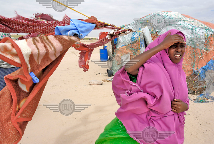 A young woman outside her shelter in Eyl, an isolated coastal village on the Hafun peninsula. The village is still recovering from the Tsunami of 2004, which destroyed at least 500 fishermen's houses and boats.