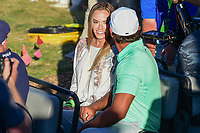 Jena Sims, Brooks Koepka's (USA) girlfriend share a ride from the 18th green following Sunday's round 4 of the 117th U.S. Open, at Erin Hills, Erin, Wisconsin. 6/18/2017.<br /> Picture: Golffile | Ken Murray<br /> <br /> <br /> All photo usage must carry mandatory copyright credit (&copy; Golffile | Ken Murray)