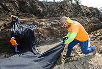 March 15, 2019. Vista, CA. USA|  Construction worker Jose Bautista, front, and others lie filter fabrics in a drainage ditch while working on future apartments at 1309 N. Santa Fe in Vista. | Photos by Jamie Scott Lytle. Copyright.